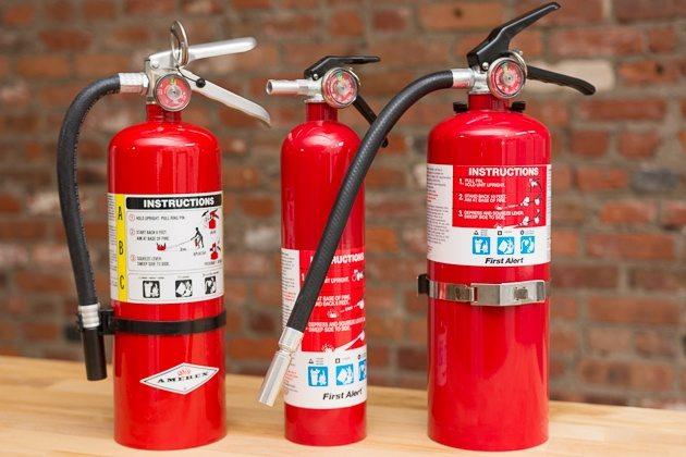 three fire extinguishers