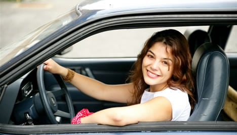 young female driver in a car image