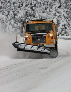 snowplow at work on snowy winter road