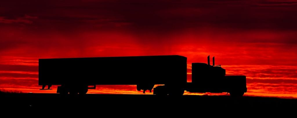 big rig on the road during a spectacular sunset