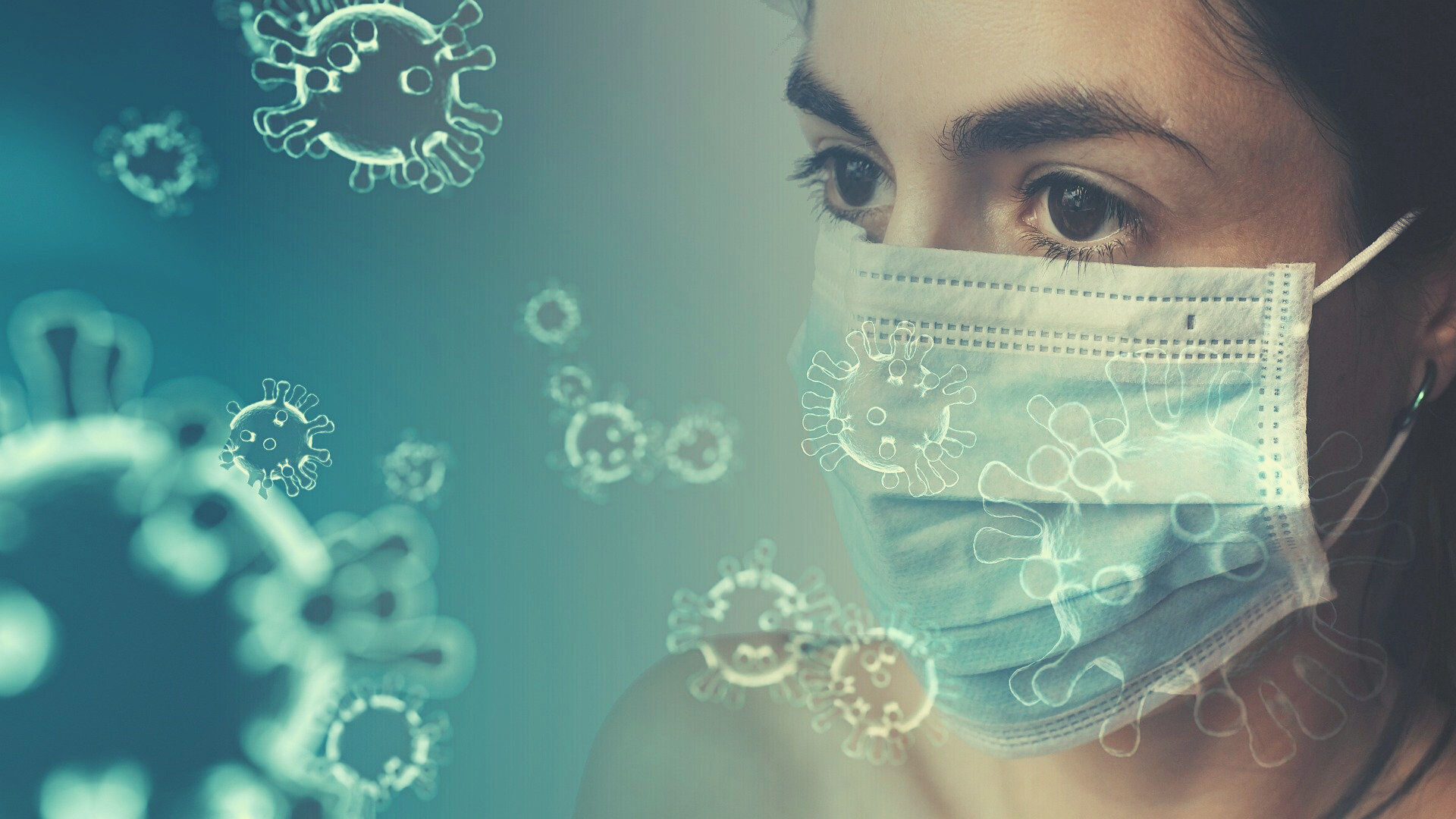 woman wearing mask with covid cells